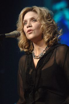 Alison Krauss.  Beautiful voice.  starpulse.com