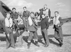 Pilots of No. 19 and No. 616 Squadrons pose by a Spitfire.