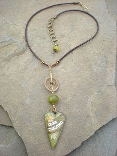 Maggie Zee green Heart necklace, ice resin, sari fabric, prehnite, i-ching coin and leather