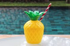 Pineapple drink container with red striped straw - perfect for parties