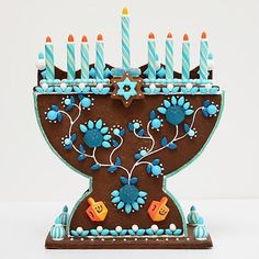 Gingerbread menorah kit I'd ditch the gingerbread and make it out of felt .  Super cute design