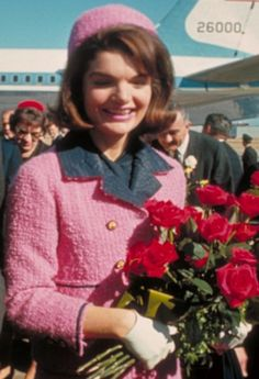 Jackie O in that classic pink Chanel suit. #SocialblissStyle #Chanel #JackieO #suit