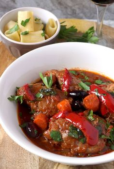 Chicken Cacciatore, slow cooked falling of the bone chicken braised in wine and tomatoes. The ultimate Italian comfort food