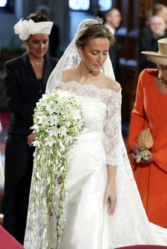 Claire Coombs marries Prince Laurent of Belgium in a lace gown designed by  Edouard Vermeulen