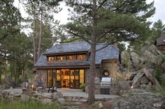 TKP Architects ~Mountain Cottage  notice how home is designed around existing boulders ~ view other photos here!