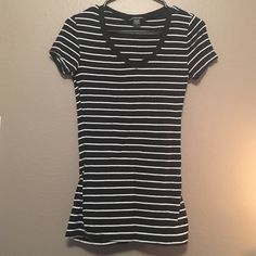 No longer fits. Black/White Stripes. V-neck blouse, form fitting. Tops Blouses