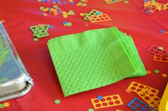 Use your Cricut Explore to cut Lego confetti and use your Cricut Cuttlebug to emboss your napkins to match your party.