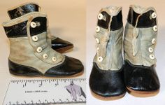 """Infant shoes, 1900. They are made of a light baby blue leather with black patent leather trim. The shoes have leather bottom soles stamped a size 4, rounded toes, 5 white buttons along the side for closure, blue tassel fringe trim hanging down the front and are lined in linen. They measure 4"""" tall, 5"""" long and 2"""" wide."""