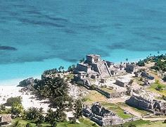 Visit the ancient Mayan ruins of Tulum, it's only a few dollars to get in and a short shuttle ride away, you can take a tour, but it isn't necessary!