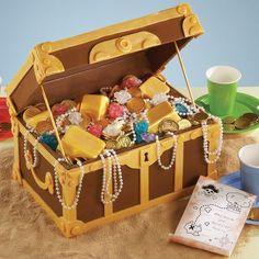 How Pirates Party Cake. Present a buccaneer's bonanza. Fill a treasure chest built from candy plaques and sheet cakes with gold candy bars and chocolate coins.