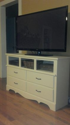 My go at refinishing a dresser into an entertainment center. Not too shabby!