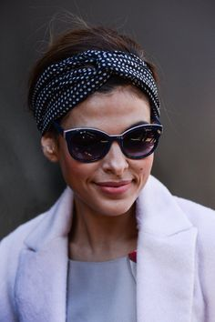 Pin for Later: New Mom Eva Mendes Never Met a Headband She Didn't Love 2013 Eva's polka dot scarf and feline-shaped shades made this Good Morning America look a retro beauty moment.