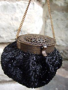 Vintage black beaded filigree clasp evening bag.