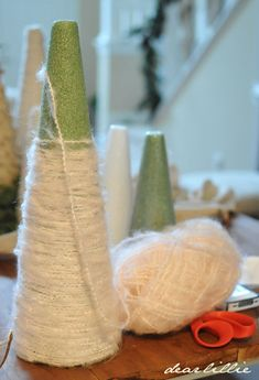 Create your own yarn Christmas trees with a foam cone, yarn, and glue by Dear Lillie Christmas Tree Yarn, Silver Christmas Decorations, Winter Christmas, Christmas Ornaments, Modern Christmas, Scandinavian Christmas, Christmas Projects, Holiday Crafts, Christmas Ideas