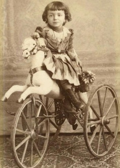 1880's French wood and ornate cast iron horse velocipede tricycle.