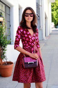 Viva Luxury wearing the DVF Jewel Wrap Dress & 440 Mini Crossbody Bag