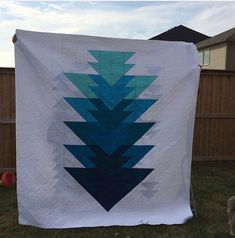 This is a beautiful queen size quilt that is 2 sided. One side features an arrow in descending shades of blue, while the other features flying geese in varying shades of blue. So you can easily change your look just by flipping it over. My Etsy Shop, Quilting, Throw Pillows, Trending Outfits, Unique Jewelry, Handmade Gifts, Vintage, Kid Craft Gifts, Toss Pillows