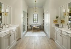 """This is most likely actual wood flooring but the color could be found in a tile. Spa feel. But I don't want to get too far from the """"elegant"""" feeling we have been going for. Place holding the idea!"""