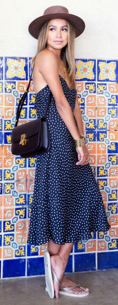 Julie Sarinana + super summery + cute spotted dress + flip flops + beachy vibes + statement heels + glamorous look.   Dress: Motel, Shoes: Havaianas