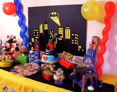 Amazing backdrop and dessert table at a superhero birthday party! See more party planning ideas at CatchMyParty.com!