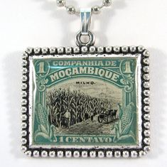 Vintage Mozambique Canceled Postage Stamp Pendant Necklace by 12be, $14.50