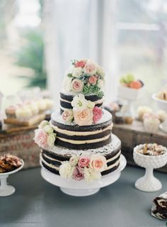 Swooning over this dreamy chocolate cake covered with pastel roses and peonies..