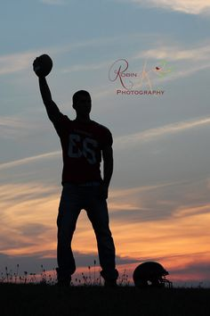 Senior boy silhouette with football