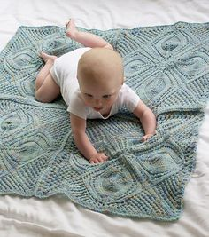 Dogwood knitting pattern by Tin Can Knits This darling baby blanket adds a…