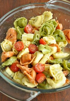 This addictive and easy Tortellini Pasta Salad is tossed with an uber-flavorful homemade dressing and is sure to vanish quickly at your next party or BBQ! Vegetarian + party-perfect, you can even make this tasty tortellini salad in advance! Healthy Recipes, Salad Recipes, Cooking Recipes, Drink Recipes, Pasta Salad With Tortellini, Cheese Tortellini, Veggie Pasta, Summer Salads, Summer Bbq