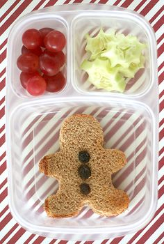 GINGERBREAD: I used a gingerbread man cutter and added a few raisins.  Then I have hollies and berries for the fruit and veggie.  Grapes for the berries and sliced cucumbers cut around the edges with a small circle for points.