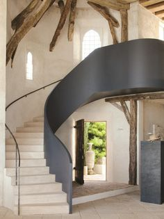 A black steel balustrade.  A modern metal staircase railing.  Very bold stair design! http://cococozy.com