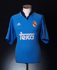 dc45e1ff970 From the classic Hummel 1986 shirt worn by Hugo Sanchez to the 2000  Champions League winning shirt (and many more) - get your own retro Real  Madrid shirt.