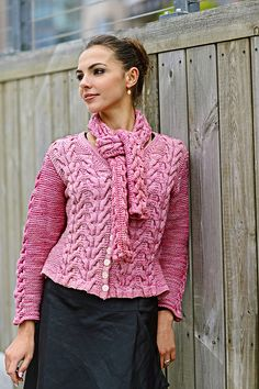 Ravelry: Tyrol Jacket pattern by Linda Marveng Inspired by the mélange soft pink color – not unlike the evening sky – and adorable Tyrol cables with their flower-bud shapes, I have designed an elegantly fitted jacket with a V-neck. The saddle sleeves allow the cables to flow all along the shoulder. A loose scarf with cables sewn into a tube works as a second shawl collar and adds textured volume.