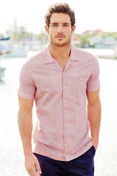 red/white textured shirt. navy shorts. boat shoes. simple. southern. summer. style.