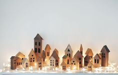 MUST SEE LINK: Tutorial for Darling paper houses as and advent calendar - (bloglovin.com)