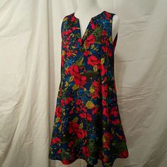 Bright Floral Dress I wore this with jeans. It's beautiful but doesn't fit me right.  It's labeled as small. I think it can be worn as a medium as well. It's funky and fun! Dresses Midi