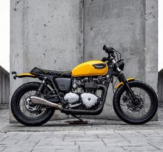 """Side view of """"The Wasp"""", featured in @pipeburn this week #macco #triumph #bonneville #t100 #tracker #streettracker #scrambler #caferacer #triumph_uk #triumphofficial #triumphbonneville #lifestyle #loveforbikes #maccomotors Pic by @sergioibarraphoto by maccomotors http://overboldmotor.co"""