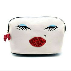 "Betsey Luv Sequin Lips Dome Cosmetic Bag Kiss those headaches goodbye because the Betsey Luv's Sequin Lips Dome Cosmetic Case can store all those important goodies for you. This pretty little cream colored bag features a full front smiley face graphic with sequin lips detail on PU leather. W 9"" x H 6"" x D 2.5 "" Betsey Johnson Bags Cosmetic Bags & Cases"