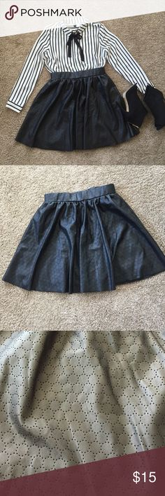 Faux Leather Skirt Like new! This is a super cute pleated skirt that has a perforated design and has lining for comfort. It doesn't have a zipper and although it is a size M it fits more like a small. This skirt is great for fall! Coating: Polyurethane; backing fabric 100% Polyester, lining 100% Polyester. Bisou Bisou Skirts