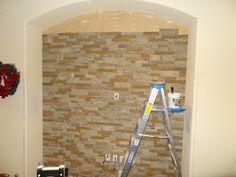 Airstone DIY stone brick wall! Step by step description of our experience with Air Stone from lowes! Awesome home improvement project for anyone!