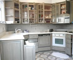 Gray Distressed Kitchen Cabinets distressed kitchen cabinets with bronze farmhouse hardware