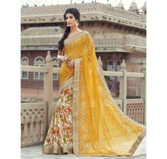 Yellow georgette and net saree with embroidered lace border.