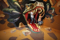 Man with his son pose for a photograph in front of a 3D painting at the 2012 Magic Art Special Exhibition in Hangzhou