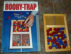 Simple concept that provided hours of fun!  My cousin Rosemary had this game at her house.  We loved playing this together and competing to see who could last the longest without springing the booby trap.