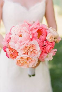 Brides.com: . Cherries Flowers, a San Francisco-based florist, created this arrangement of pink-and-coral peonies and garden roses.
