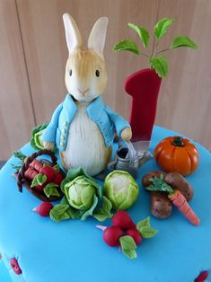 Peter Rabbit Cake Peter Rabbit cake, extended tier rich chocolate cake with ganache and covered in fondant. Finished with fondant detailing. Peter Rabbit Figurines, Peter Rabbit Cake, Peter Rabbit Birthday, Peter Rabbit Party, Garden Cupcakes, Easter Cupcakes, Fondant Rabbit, Beatrix Potter Cake, Peter Rabbit And Friends