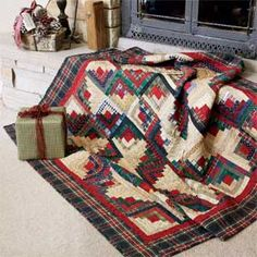 Home Is Where the Heart Is: Quick Classic Log Cabin Lap Quilt Pattern Designed by LYNN LISTER Machine Quilted by KAREN NIEMI