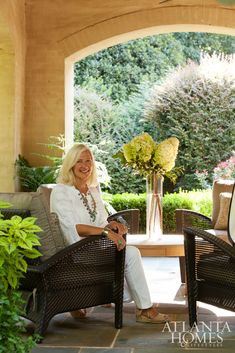 Designer Margaret Bosbyshell of Margaux Interiors enjoys her clients' stucco-walled and bluestone-floored patio in a Trinidad lounge chair by Woodard from Logan Gardens.