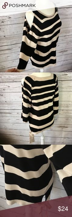 """Black & tan striped cold shoulder sweater Long Loose fit black & tan sweater with wide 3/4 length sleeves slit at the shoulder. Rayon & nylon blend. Excellent condition, no stains or pilling.                                      -Measurements taken with item laying flat and are approximate.             •Armpit to armpit• 18"""".                    •Length• 26 1/2"""".                            Sleeve length• 10"""" Roz & Ali Sweaters"""