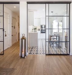 Really like to option to close off a space, but still allow an open feel with the glass. Also like patterned kitchen floor.